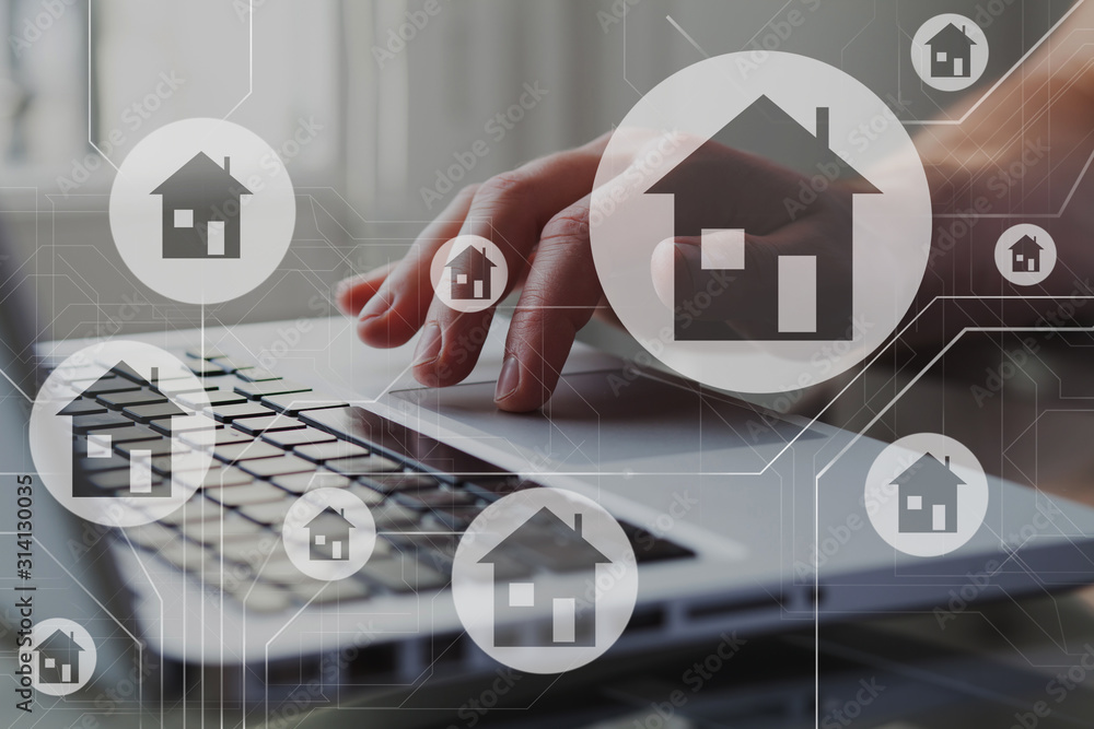 Fototapeta Real estate concept. Houses on schema diagram. Person search, compare and select proper rent apartment in laptop.