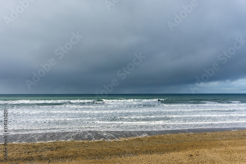 stormy clouds and waves at Widemouth Bay , Bude in Cornwall Canvas Print