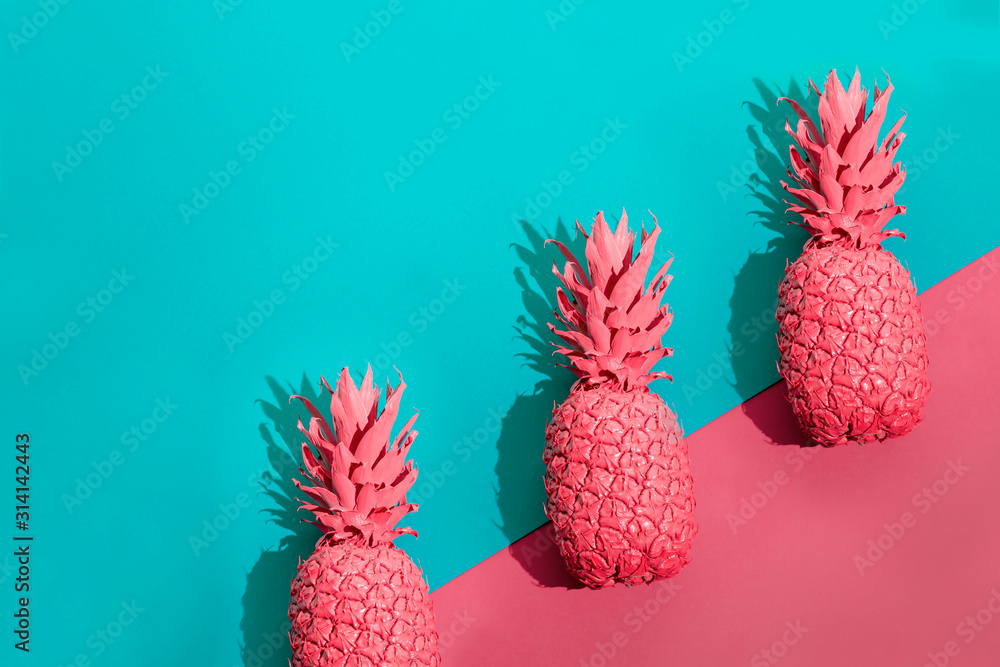 Color pineapple on pink and blue background. Surreal minimalistic art