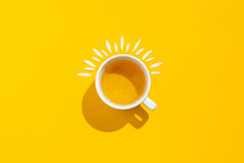 Hot Drink, Cup Of Tea With Chamomile And Lemon On A Yellow Background
