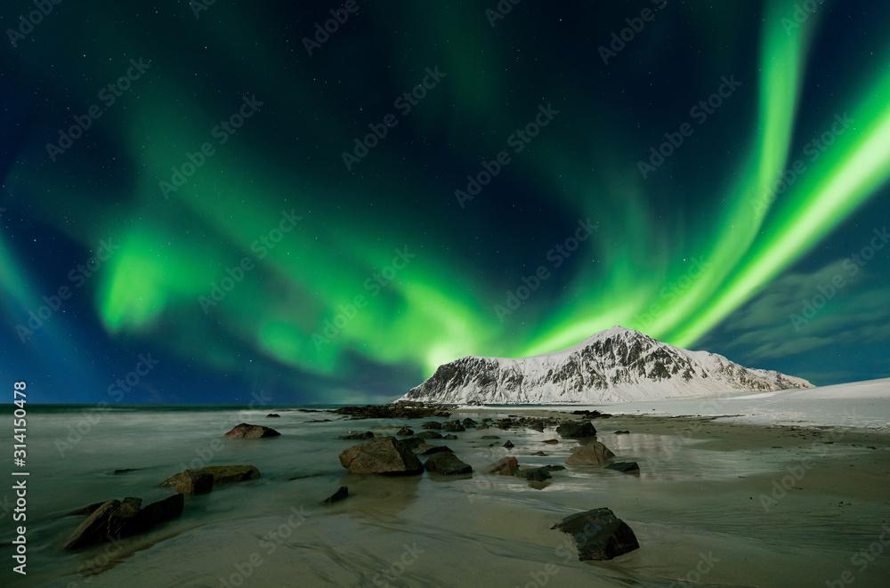 Fototapeta Aurora borealis also called northern lights over skagsanden beach in Norway