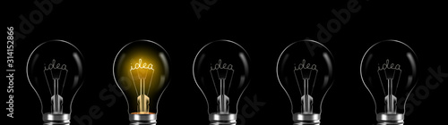 Obraz Creativity and innovation concept. idea word shining in the bulb - fototapety do salonu
