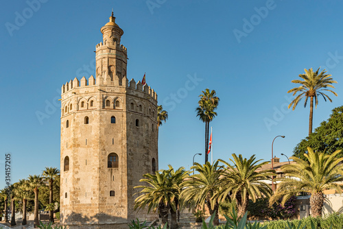 View of Golden Tower in Seville, Andalusia, Spain. Used as a military Moorish watchtower along the Guadalquivir river