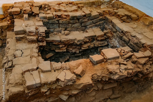 Archaeological excavations. Remnants of ruined ancient buildings Canvas Print