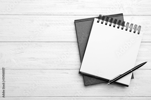 Stylish notebooks and pen on white wooden table, top view Canvas Print
