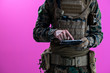 canvas print picture - soldier using tablet computer closeup