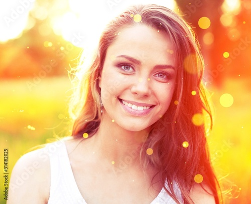 Young woman on park under sunset light Tablou Canvas