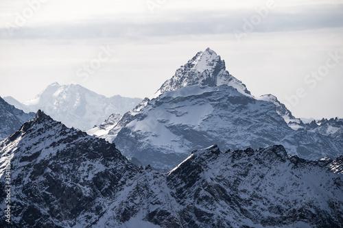 Majestic mountain peak covered in snow. Caucasian ridge Canvas Print