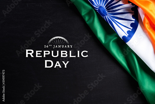 Obraz Indian republic day concept. Indian flag with the text Happy republic day against a blackboard background. 26 January. - fototapety do salonu