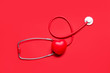 canvas print picture - Modern stethoscope and red heart on color background