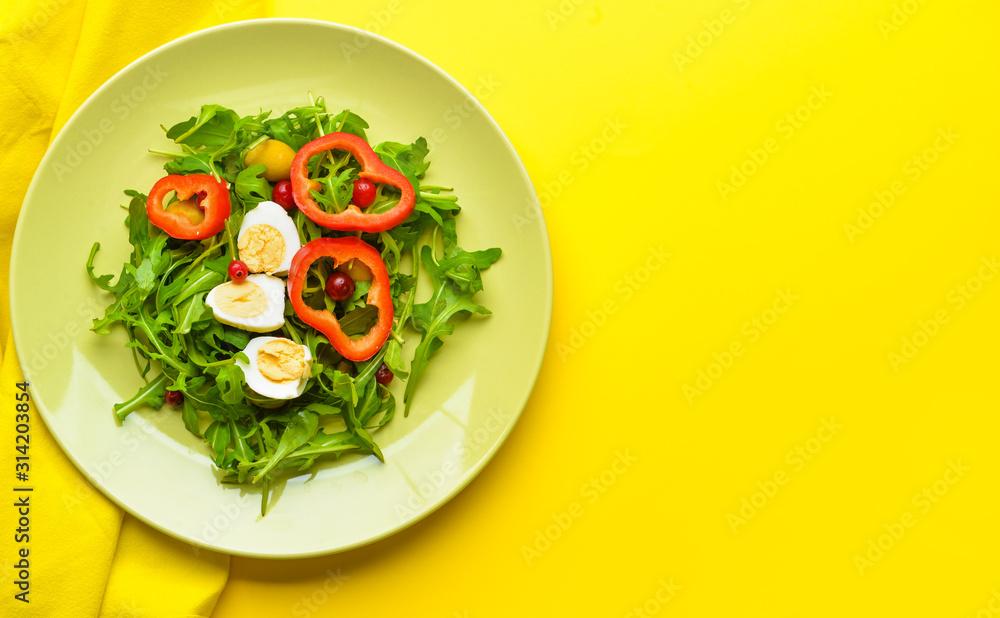 Fototapeta Plate with tasty salad on color background