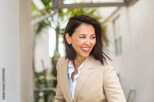 Cuadros en Lienzo Portrait of a confident Asian businesswoman smiling.