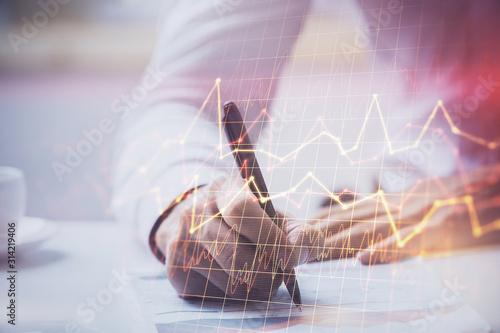 Fototapeta Financial trading graph multi exposure with man desktop background. obraz