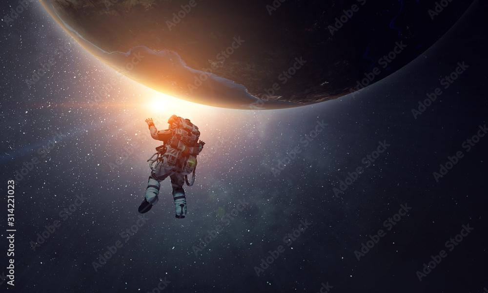 Fototapeta Exploring outer space. Mixed media