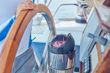 Sailor Using Wheel To Steer Ru...