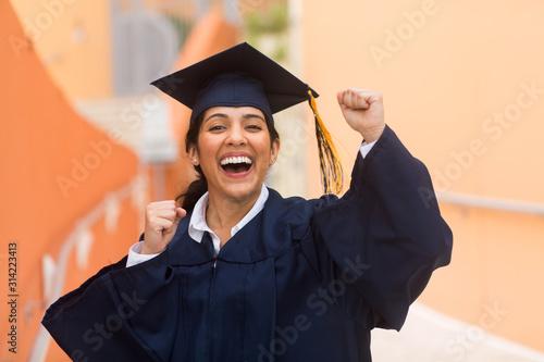 Young hispanic female graduate at her graduation Canvas Print