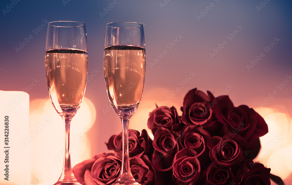 Fototapeta Valentine's Day, and romantic date night concept.  Champagne and roses.