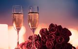 Fototapeta Kawa jest smaczna - Valentine's Day, and romantic date night concept.  Champagne and roses.