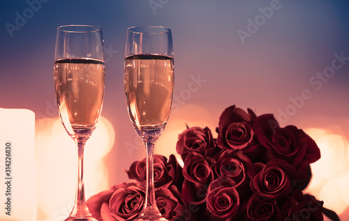 Fototapeta Valentine's Day, and romantic date night concept.  Champagne and roses.  obraz