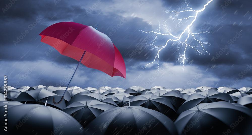 Fototapeta Red Umbrella with Crowd of black Umbrellas in Rain and Thunderstorm wit Lightning Sprache für Stichwörter: English