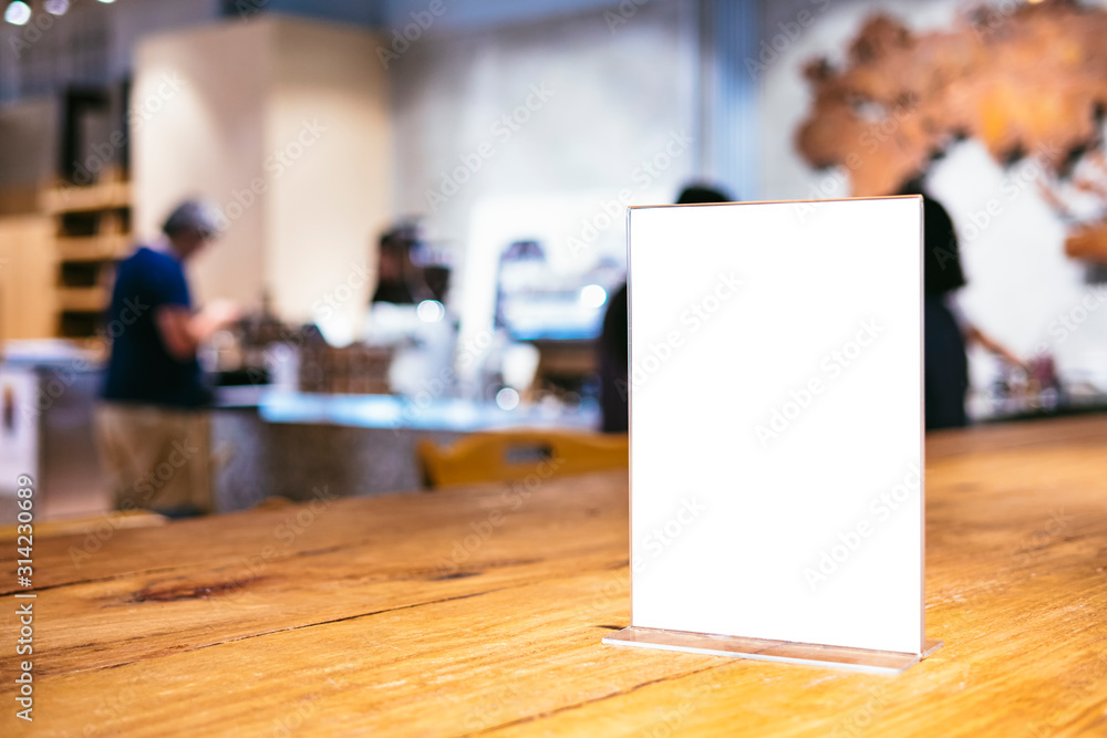 Fototapeta Mock up Menu frame on Table indoor Bar restaurant cafe background with people