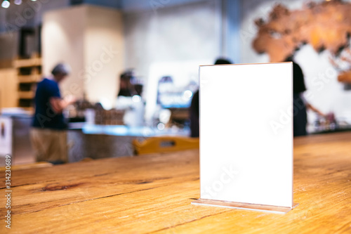 Obraz Mock up Menu frame on Table indoor Bar restaurant cafe background with people - fototapety do salonu