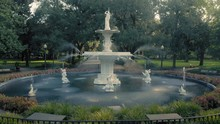 Aerial:  Fountain & Oak Trees With Rays Of Light Shining Through. Forsyth Park. Savannah, Georgia, USA.