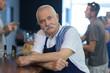 canvas print picture - portrait of a senior barman