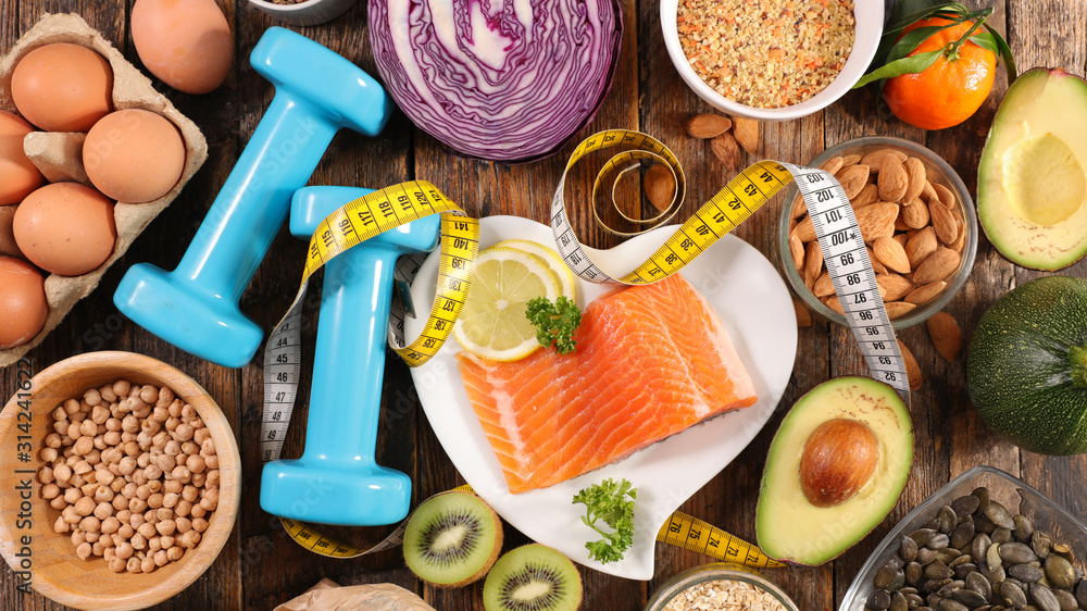 Fototapeta health food assortment-healthy lifestyle with salmon, egg, fruit and vegetable