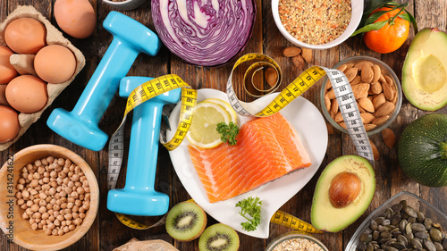 Fototapeta health food assortment-healthy lifestyle with salmon, egg, fruit and vegetable obraz