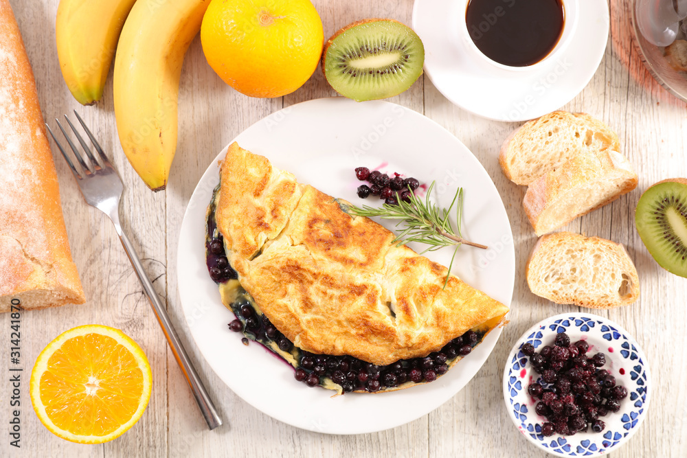 Fototapeta omelet with blueberries, fruit and coffee cup