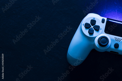 Photographie Video game gaming controller night with lights dark background top view