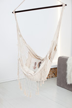 Modern Hammock In Living Room Interior. A Cozy Hammock In A Stylish Day Room. Stylish Bedroom With Natural String Hammock. Apartment Design In Loft And Rustic Style. Cozy Housing. Place For Relax