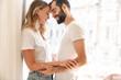 Leinwandbild Motiv Smiling young couple embracing