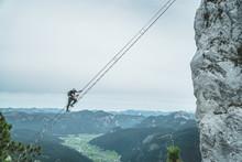 Via Ferrata Intersport Klettersteig - Climbing Up A Long Ladder