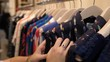 Close-up of woman's hands shopping for new clothes
