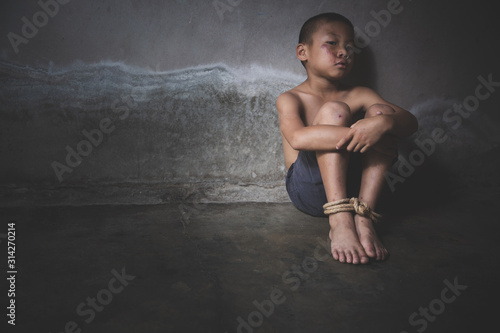 Fototapeta  Child who are victims of the human trafficking process and have  bruises on the body