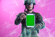 canvas print picture - soldier showing a tablet with a blank green screen