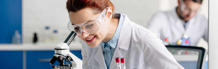 panoramic shot of genetic consultant doing dna test in lab