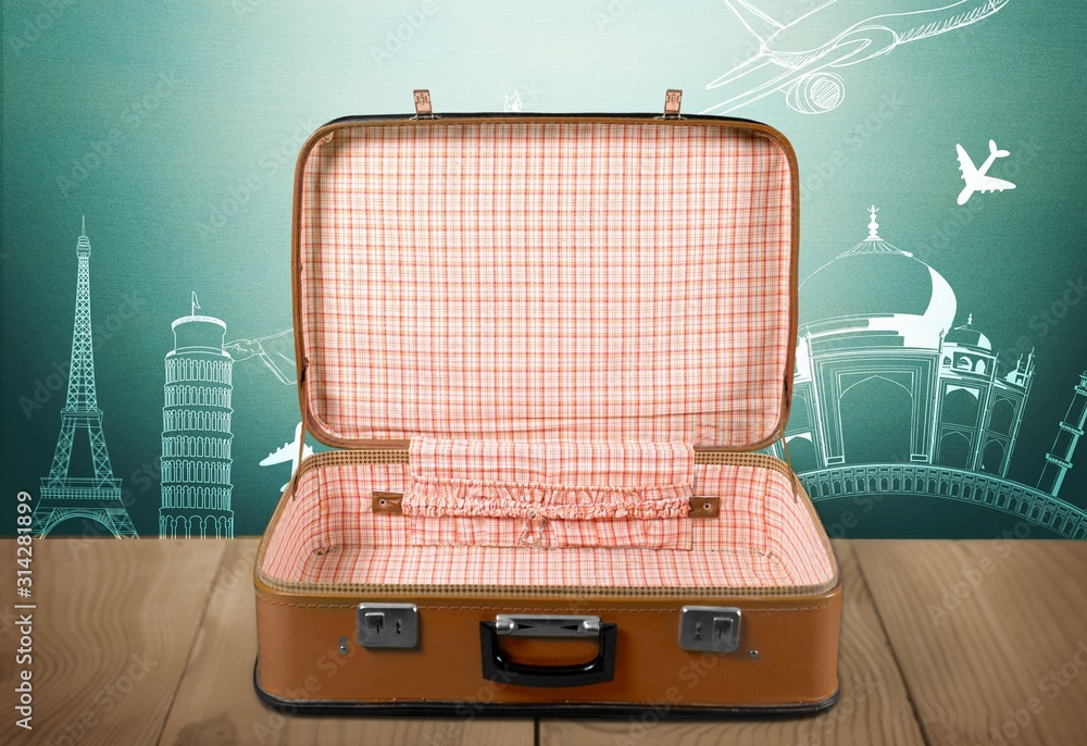 Fototapeta Vintage retro brown suitcase on desk