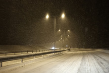 Highway In Snowstorm At Night.