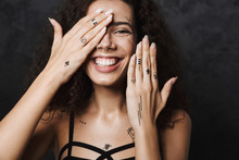 Image Of Young Cheerful Woman Smiling And Covering Her Face
