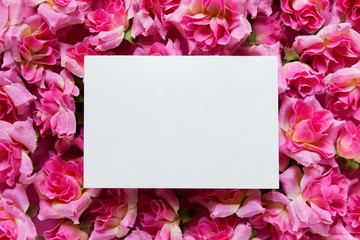 Presentation mockup with white empty blank card on surface with pink flowers roses.