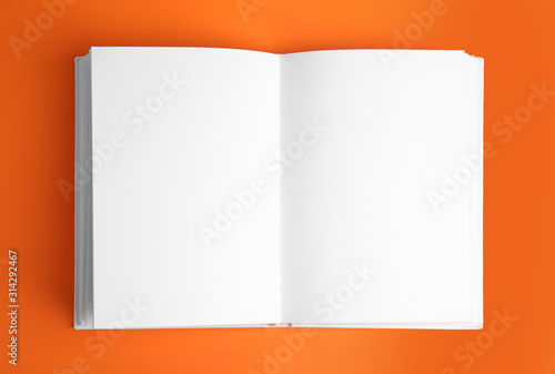 Obraz Open book with blank pages on orange background - fototapety do salonu