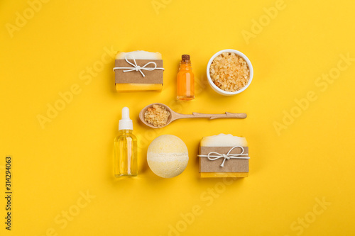 Obraz Flat lay composition with natural handmade soap on yellow background - fototapety do salonu