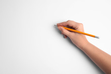 Woman Holding Pencil On White Background, Top View