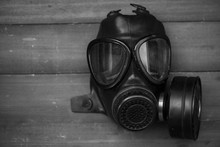 Black Gas Mask On Wood Backgro...