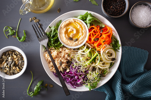 Obraz veggie couscous lunch bowl with spiralazed carrots and zucchini, hummus and red cabbage - fototapety do salonu