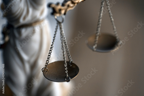 Fotografia Symbol of law and justice on wooden table in lawyer office