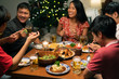 Group of Asian people have a dinner party and beer at home.